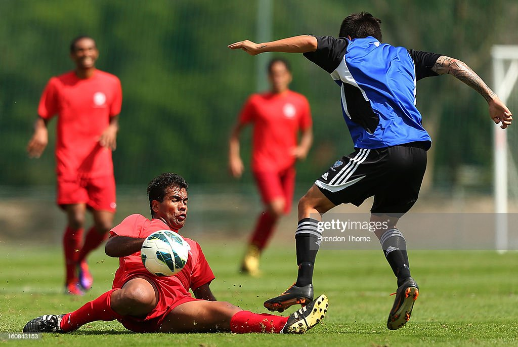Samuel Hnanyine of Tahiti dives in for a tackle during the friendly match between Sydney FC and Tahiti at Macquarie Uni on February 6, 2013 in Sydney, Australia.