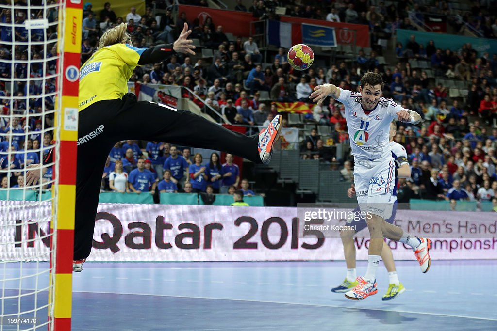 Samuel Honrubia of France (R) scores a goal against <a gi-track='captionPersonalityLinkClicked' href=/galleries/search?phrase=Bjoergvin+Pall+Gustavsson&family=editorial&specificpeople=5488616 ng-click='$event.stopPropagation()'>Bjoergvin Pall Gustavsson</a> of Iceland (L) during the round of sixteen match between Iceland and France at Palau Sant Jordi on January 20, 2013 in Barcelona, Spain.