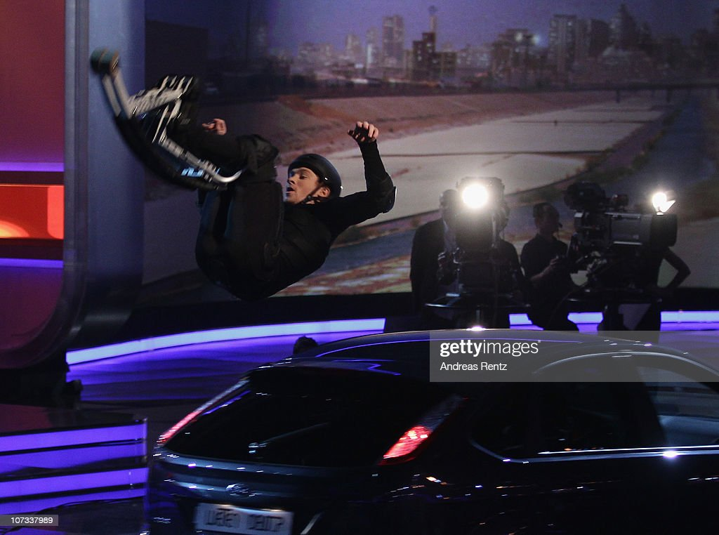 Samuel Koch jumps over the third car of five cars during the 192th 'Wetten dass ' show at the exhibition hall Dusseldorf on December 4 2010 in...