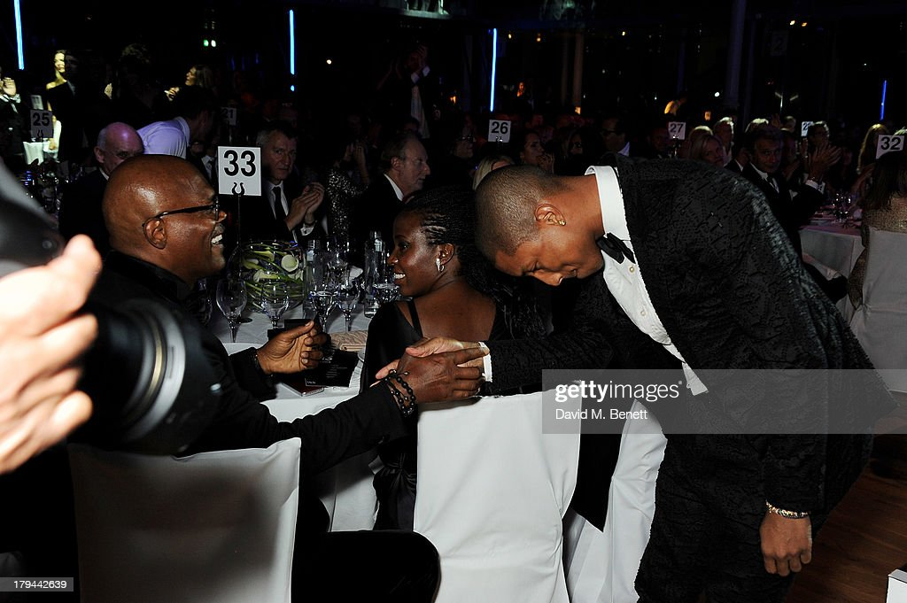 Samuel L. Jackson (L) and Pharrell Williams, winner of Best Performer, attend the GQ Men of the Year awards at The Royal Opera House on September 3, 2013 in London, England.