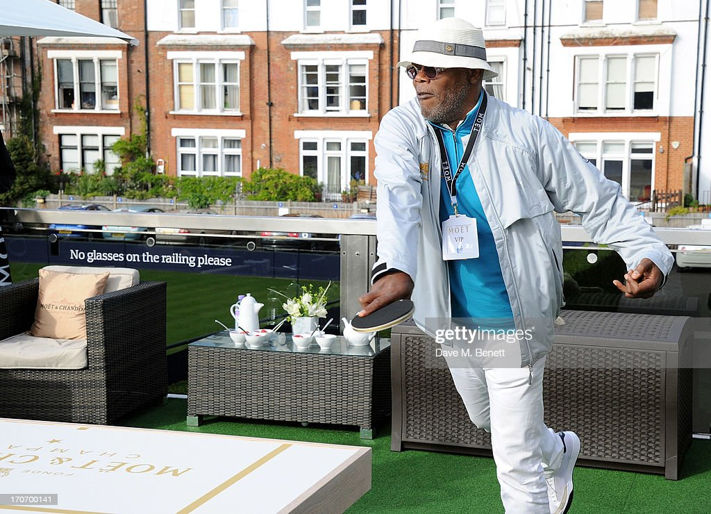 Samuel L. Jackson plays table tennis at The Moet & Chandon Suite at The Aegon Championships Queens Club finals on June 16, 2013 in London, England.