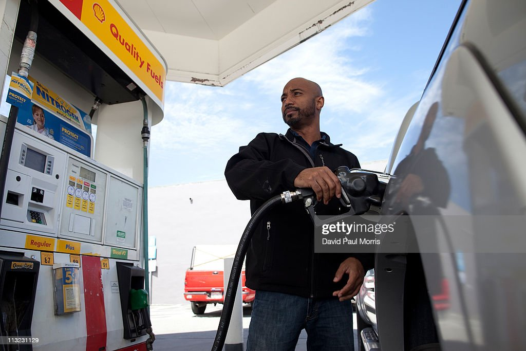 Samuel Lamb of San Jose fills his truck with gasoline at a Shell gas station on April 27, 2011 in San Francisco, California. The average price for a gallon of regular gasoline in California increased 1.2 cents to $4.217 getting closer to the all time high of $4.588.