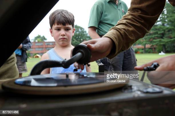 Samuel Loureiro studies a WWI era record player during the World War I Living History Weekend in Devens MA on Aug 5 2017 Fort Devens marked the World...