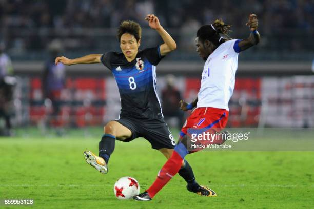 Samuel Maedochee Pompe of Haiti and Genki Haraguchi of Japan compete for the ball during the international friendly match between Japan and Haiti at...