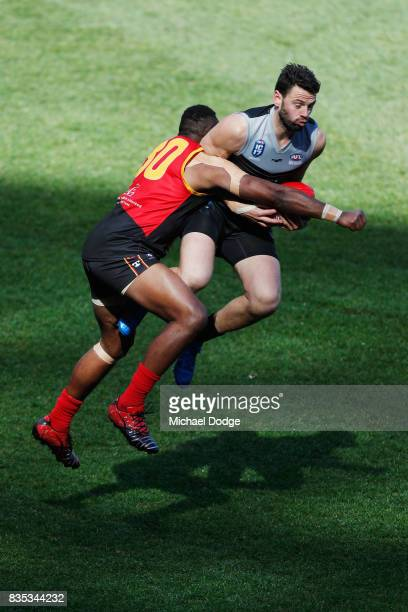 Samuel McKENZIE of New Zealand marks the ball against Greg Paul AKI during the 2017 AFL International Cup Grand FInal match between New Zealand and...