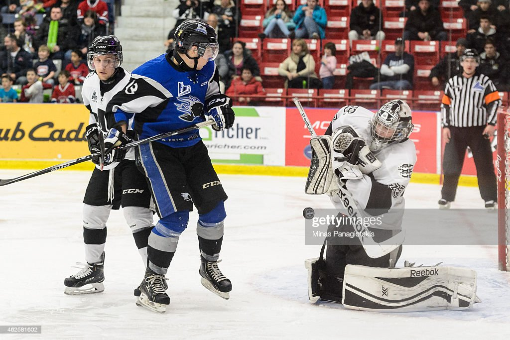 Samuel Montembeault #33 of the Blainville-Boisbriand Armada makes a save near Justice Dundas #13 of the Saint John Sea Dogs during the QMJHL game at the Centre Excellence Rousseau on January 31, 2015 in Blainville-Boisbriand, Quebec, Canada.