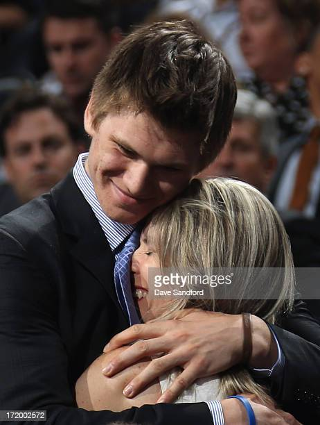 Samuel Morin celebrates with his family after being selected 11th overall by the Philadelphia Flyers during the 2013 NHL Draft at Prudential Center...