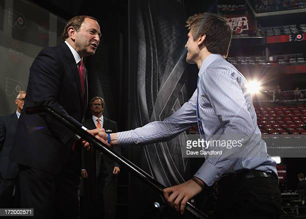 Samuel Morin is congratuleted by NHL commissioner Gary Bettman after being selected 11th overall by the Philadelphia Flyers during the 2013 NHL Draft...