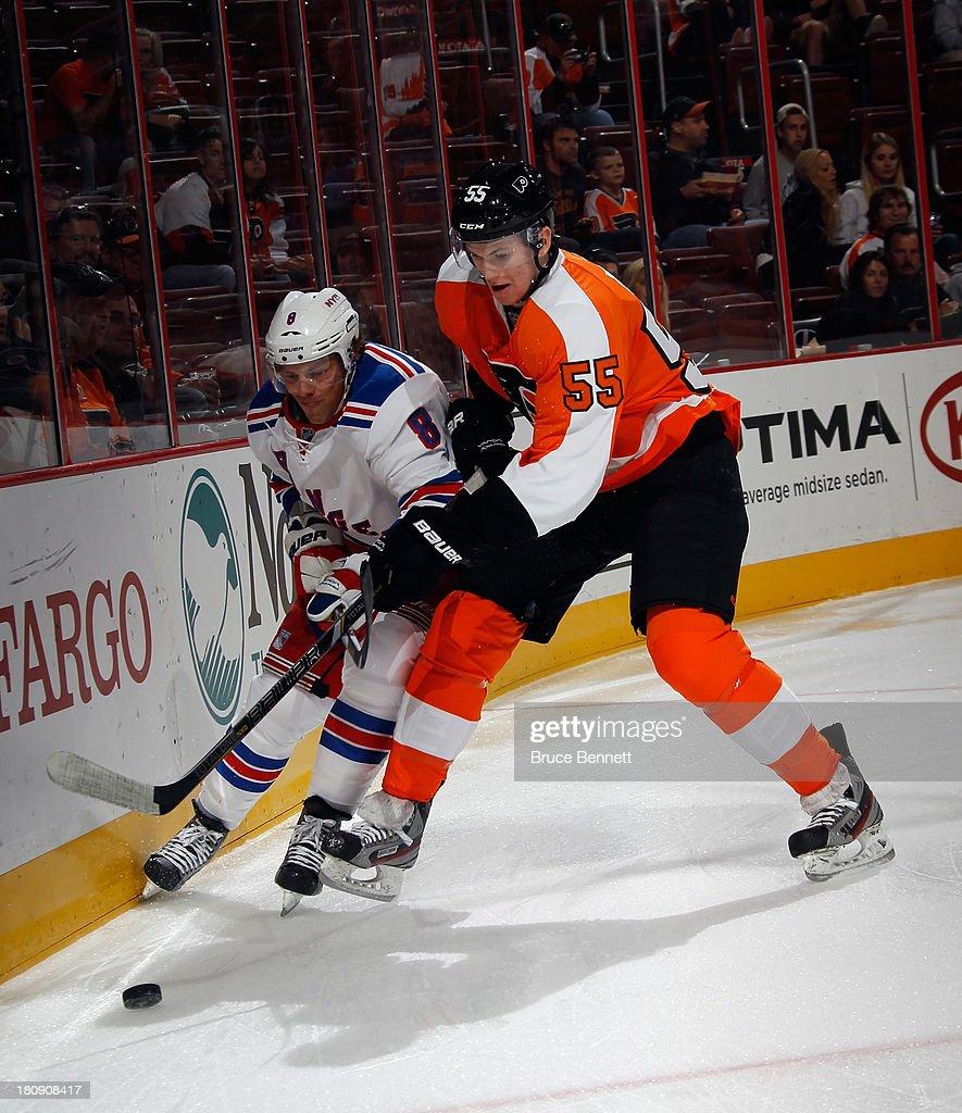 Samuel Morin of the Philadelphia Flyers checks Darroll Powe of the New York Rangers during a preseason game at the Wells Fargo Center on September 17...