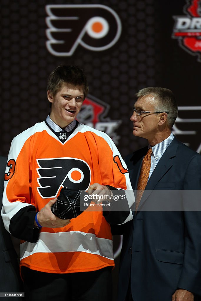 Samuel Morin poses with the General Manager Paul Holmgren after being selected number eleven overall in the first round by the Philadelphia Flyers...