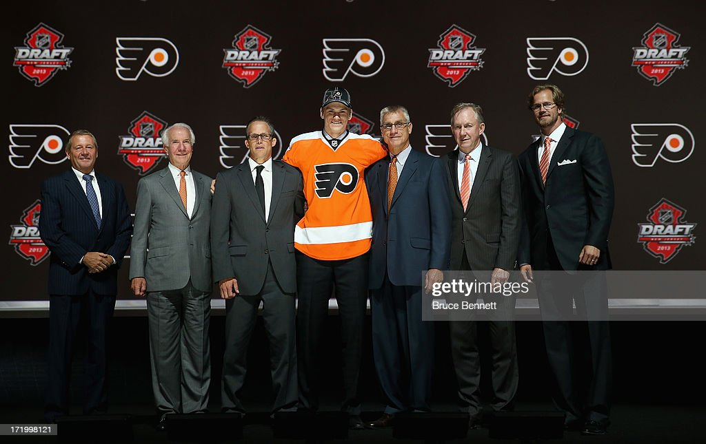 Samuel Morin poses with the General Manager Paul Holmgren and the front office after being selected number eleven overall in the first round by the...