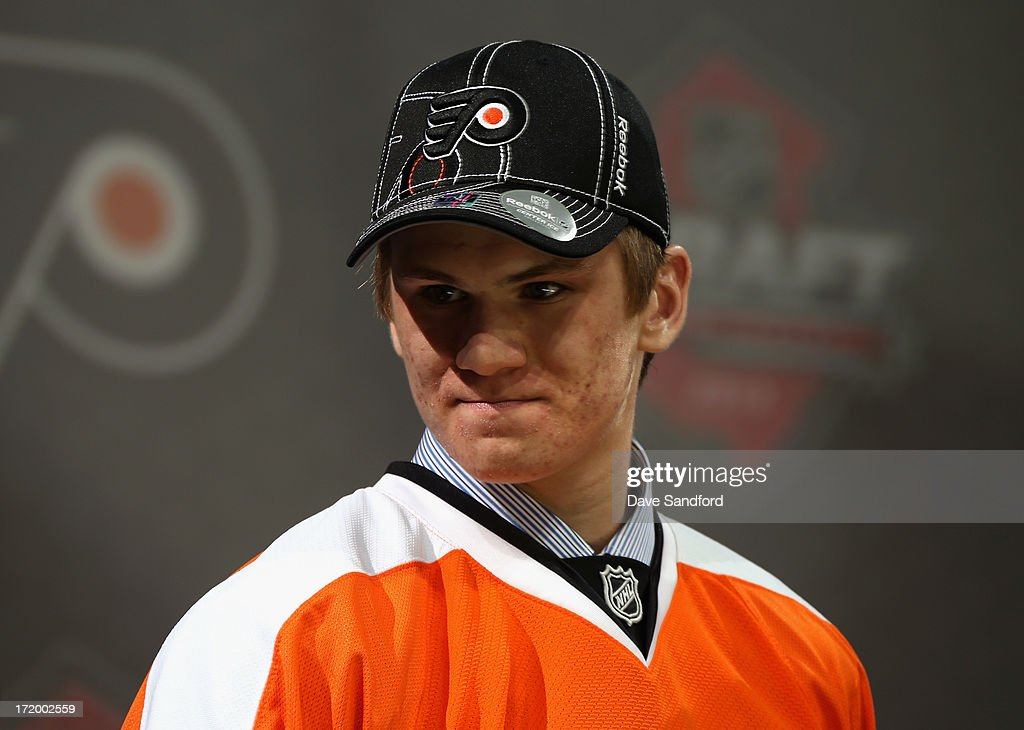 Samuel Morin smiles on stage after being selected 11th overall by the Philadelphia Flyers during the 2013 NHL Draft at Prudential Center on June 30...