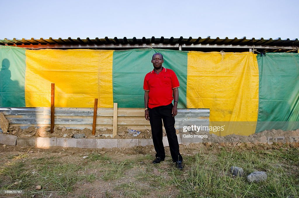 Samuel Motsoanakaba, a mineworker at Harmony Gold's Kusasalethu Mine stands outside a church on January 17, 2013 in Carltonville, South Africa. About 80 miners found themselves stranded and had to find refuge at a church after they were locked out Kusasalethu's mine hostels. The Kusasalethu shaft has been temporarily shut down due to violence and illegal sit-ins at the mine.