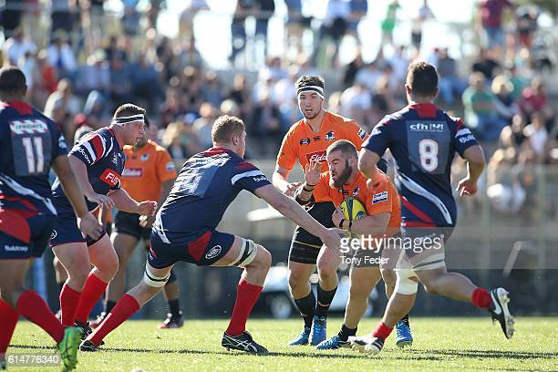 Samuel Needs of the Country Eagles is tackled by the Melbourne Rising defence during the NRC Semi Final match between the NSW Country Eagles and...