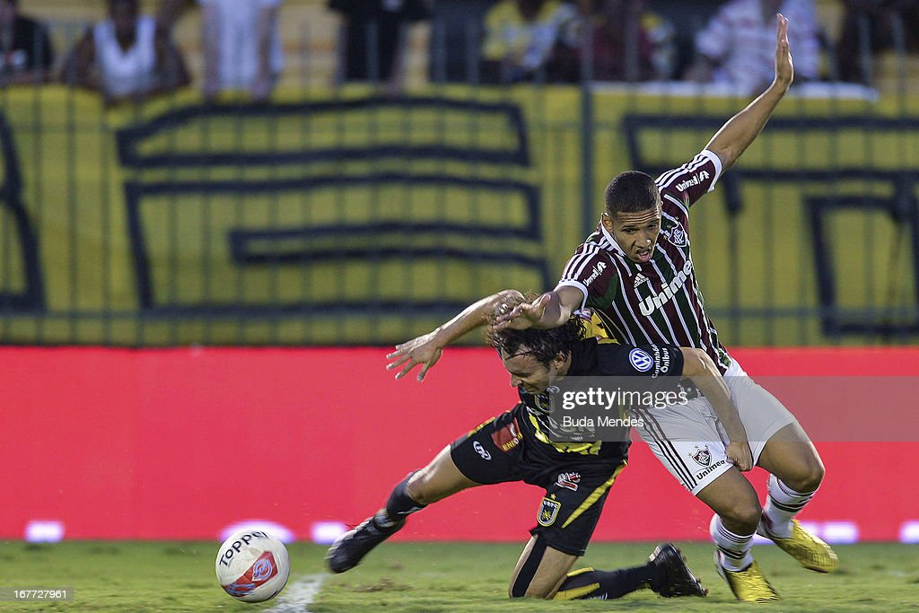 Samuel of Fluminense fights for the ball during the match between Fluminense and Volta Redonda as part of Rio State Championship 2013 at Raulino de Oliveira Stadium on April 28, 2013 in Volta Redonda, Brazil.