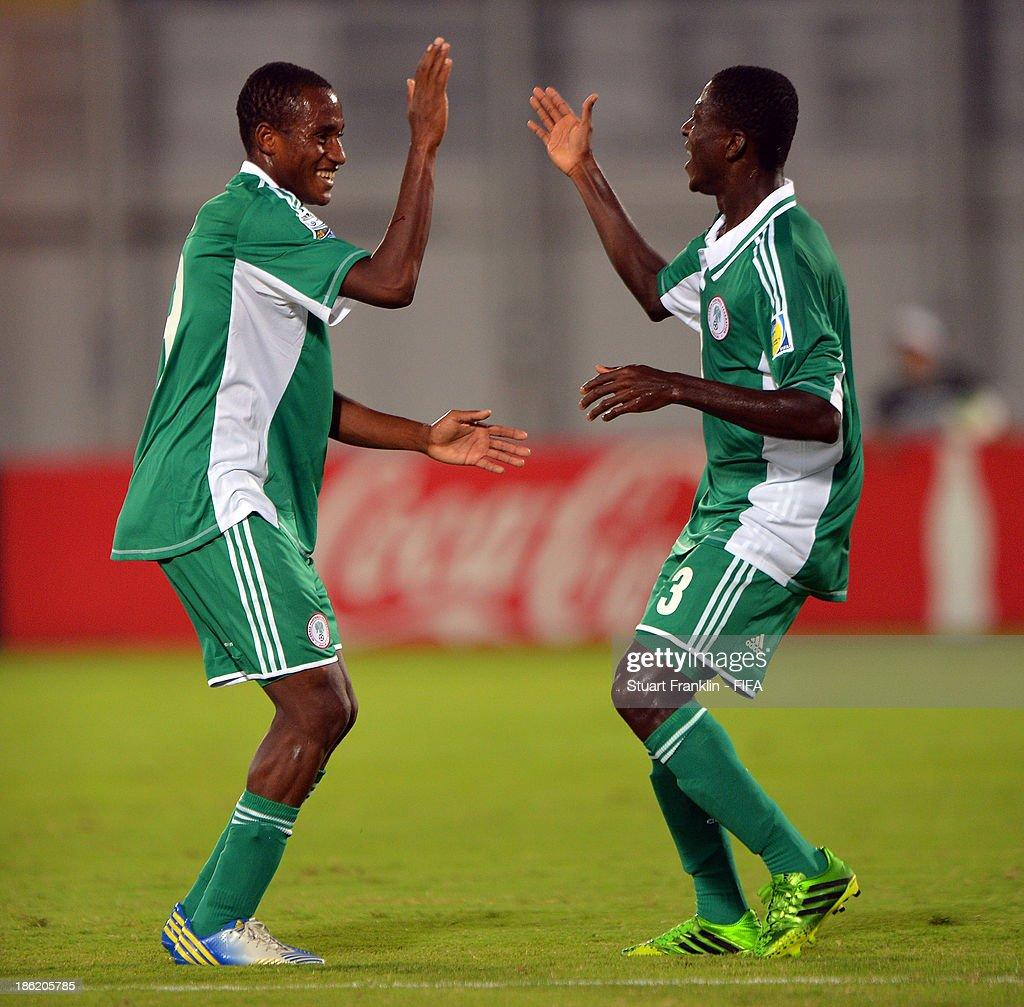 Samuel Okon of Nigeria celebrates scoring his goal with Zaharaddeen Bello during the round of 16 match between Nigeria and Iran at Khalifa Bin Zayed Stadium on October 29, 2013 in Al Ain, United Arab Emirates.