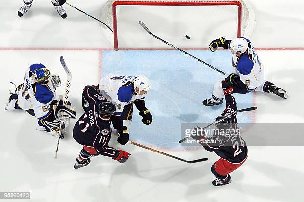 Samuel Pahlsson celebrates after Chris Clark both of the Columbus Blue Jackets beat goaltender Chris Mason of the St Louis Blues to score during the...