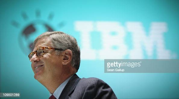 Samuel Palmisano President and CEO of IBM walks by an IBM logo as he tours the IBM stand at the CeBIT technology trade fair on February 28 2011 in...