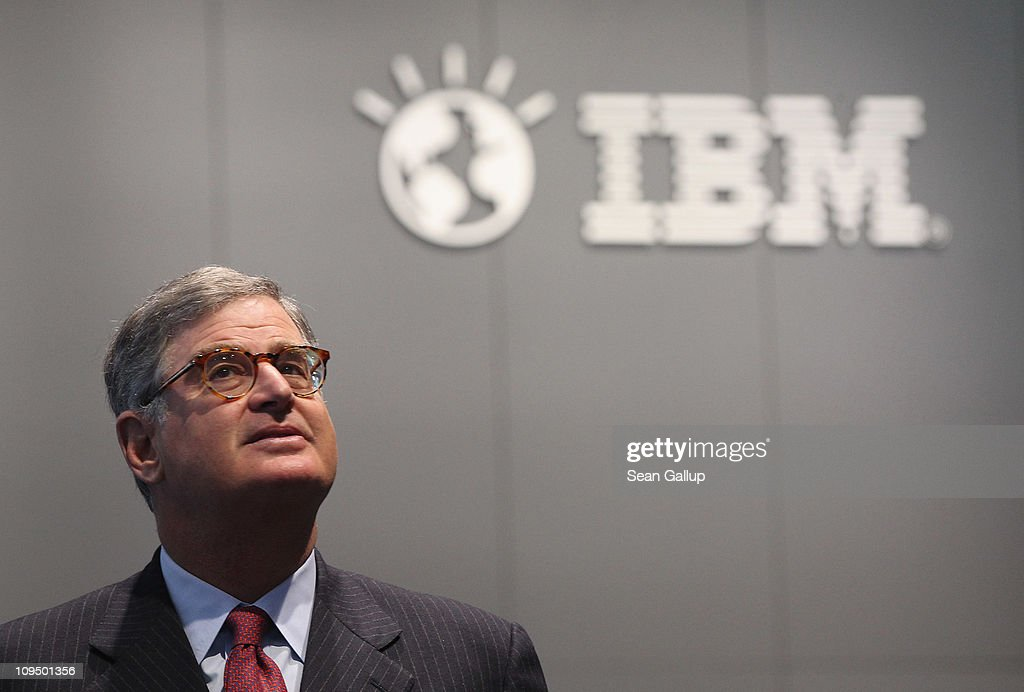 Samuel Palmisano, President and CEO of IBM, walks by an IBM logo as he tours the IBM stand at the CeBIT technology trade fair on February 28, 2011 in Hanover, Germany. CeBIT 2011 will be open to the public from March 1-5.