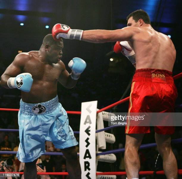 Samuel Peter moves in to throw a body shot as Wladimir Klitschko misses with a right jab Klitschko went on to win a unanimous decision over Peter...