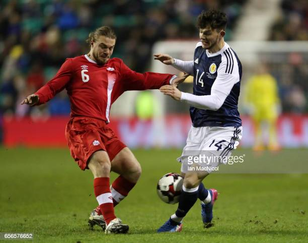 Samuel Piette of Canada vies with Oliver Burke of Scotland during the International Challenge Match between Scotland and Canada at Easter Road on...