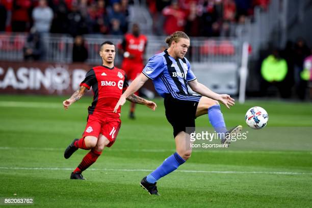 Samuel Piette of Montreal Impact stops the ball in air during the first half of the MLS Soccer regular season game between Toronto FC and Montreal...