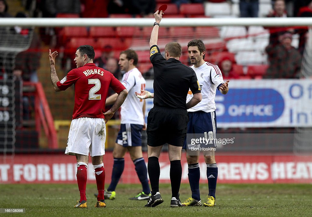 Samuel Ricketts of Bolton is sent off by Referee Trevor Kettle during the npower Championship match between Charlton Athletic and Bolton Wanderers at the Valley on March 30, 2013 in London, England.