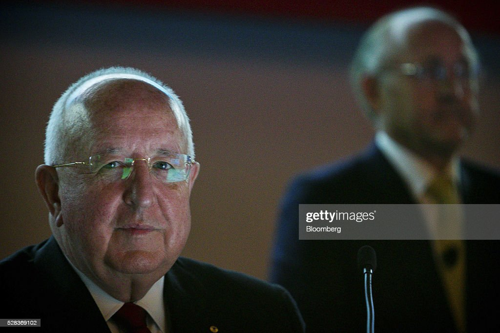 Samuel 'Sam' Walsh, outgoing chief executive officer of Rio Tinto Group, left, and <a gi-track='captionPersonalityLinkClicked' href=/galleries/search?phrase=Jan+du+Plessis+-+Businessman&family=editorial&specificpeople=14477870 ng-click='$event.stopPropagation()'>Jan du Plessis</a>, chairman, attend the company's annual general meeting in Brisbane, Australia, on Thursday, May 5, 2016. Rio Tinto Group, the second-largest mining company, reaffirmed its goal to raise annual iron ore output in Australia to 360 million metric tons amid forecast growth demand in Asia. Photographer: Patrick Hamilton/Bloomberg via Getty Images