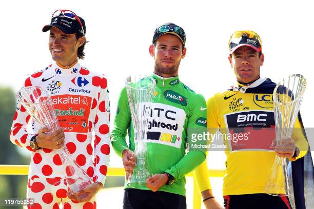 Samuel Sanchez of team Euskatel winner of the polka dot king of the mountains competition Mark Cavendish of team HTC winner of the points jersey and...