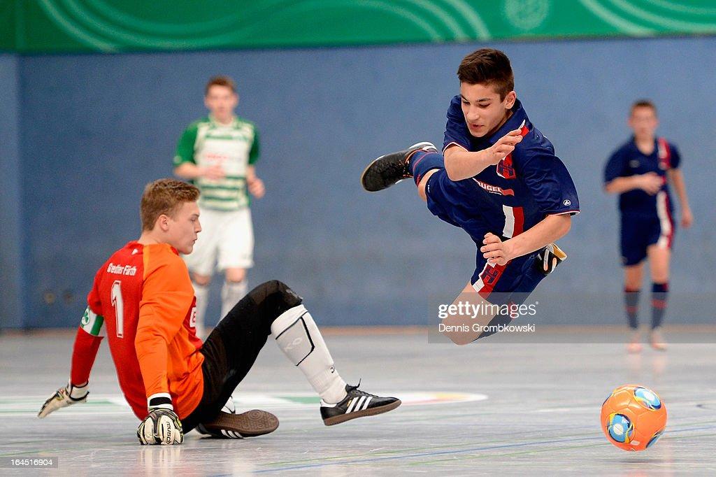 Samuel Schmitt of Hollenbach is fouled by goalkeeper Jan Kowalewski of Fuerth during the DFB C Juniors Futsal Cup semifinal match between SpVgg...