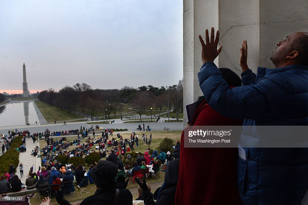 Samuel Semegn, right, attends the 35th Annual Sunrise Celebration at the Lincoln Memorial on Sunday March 31, 2013 in Washington, DC. Scores of people turned out for the Easter sunrise service.
