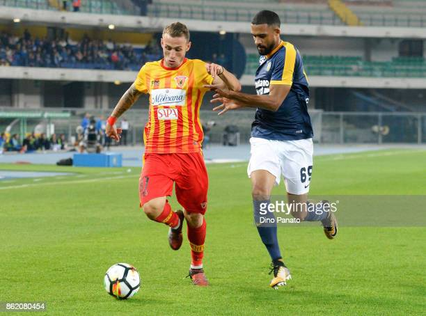 Samuel Souprayen of Hellas Verona FC competes with Cristiano Lombardi of Benevento Calcio during the Serie A match between Hellas Verona FC and...