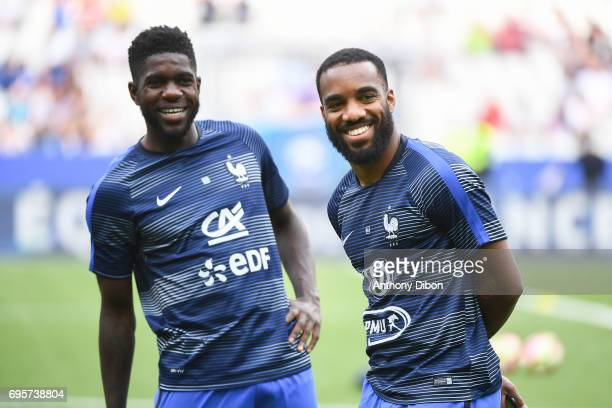 Samuel Umtiti and Alexandre Lacazette of France during the International friendly match between France and England at Stade de France on June 13 2017...