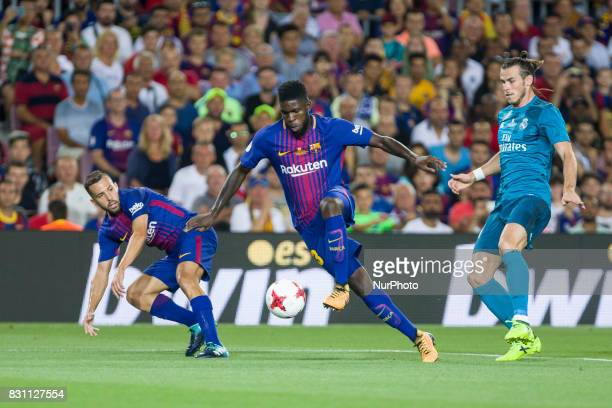 Samuel Umtiti and Gareth Bale during the match between FC Barcelona Real Madrid for the first leg of the Spanish Supercup held at Camp Nou Stadium on...