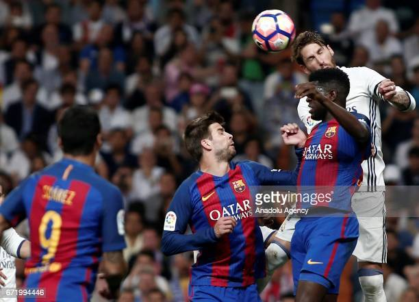 Samuel Umtiti and Gerard Pique of Barcelona in action against Sergio Ramos of Real Madrid during the La Liga match between Real Madrid and Barcelona...