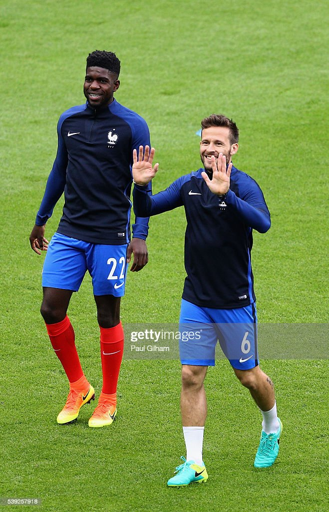 <a gi-track='captionPersonalityLinkClicked' href=/galleries/search?phrase=Samuel+Umtiti&family=editorial&specificpeople=7123899 ng-click='$event.stopPropagation()'>Samuel Umtiti</a> (L) and <a gi-track='captionPersonalityLinkClicked' href=/galleries/search?phrase=Yohan+Cabaye&family=editorial&specificpeople=648909 ng-click='$event.stopPropagation()'>Yohan Cabaye</a> of France are seen during the warm up prior to the UEFA Euro 2016 Group A match between France and Romania at Stade de France on June 10, 2016 in Paris, France.