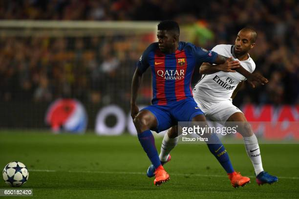 Samuel Umtiti of Barcelona and Lucas of Paris SaintGermain compete for the ball during the UEFA Champions League Round of 16 second leg match between...
