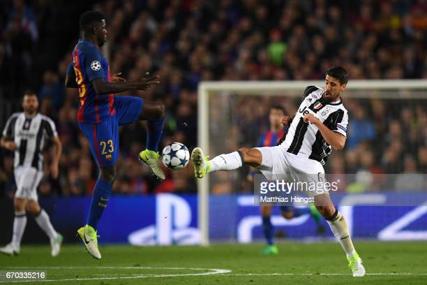 Samuel Umtiti of Barcelona and Sami Khedira of Juventus battle for possession during the UEFA Champions League Quarter Final second leg match between...