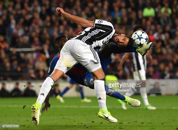 Samuel Umtiti of Barcelona and Sami Khedira of Juventus compete for the ball during the UEFA Champions League Quarter Final second leg match between...