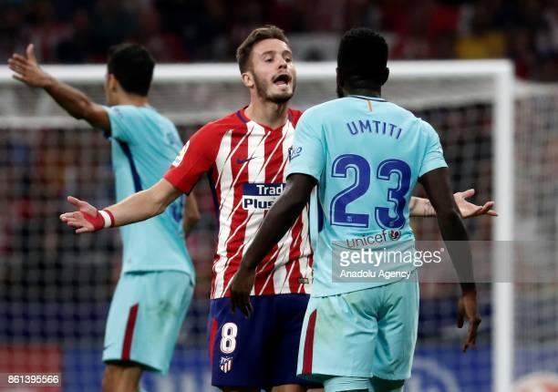 Samuel Umtiti of Barcelona and Saul Niguez of Atletico Madrid argue during the Spanish La Liga match between Atletico Madrid and Barcelona at Wanda...