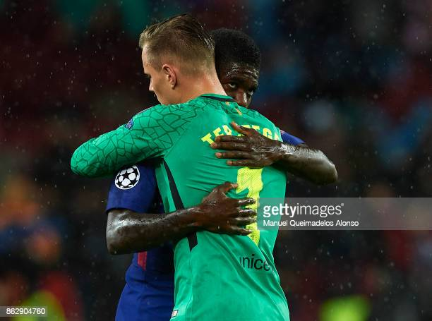 Samuel Umtiti of Barcelona and Ter Stegen of Barcelona embrace prior to the UEFA Champions League group D match between FC Barcelona and Olympiakos...
