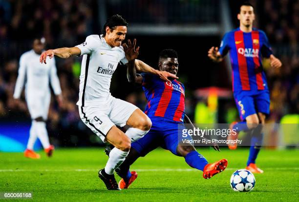 Samuel Umtiti of Barcelona challenges Edinson Cavani of PSG for the ball during the UEFA Champions League Round of 16 second leg match between FC...
