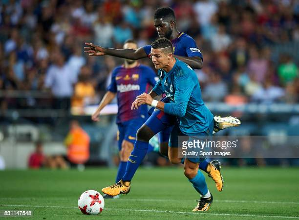 Samuel Umtiti of Barcelona competes for the ball with Cristiano Ronaldo of Real Madrid during the Supercopa de Espana Supercopa Final 1st Leg match...