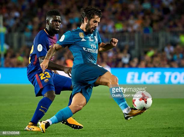 Samuel Umtiti of Barcelona competes for the ball with Isco of Real Madrid during the Supercopa de Espana Supercopa Final 1st Leg match between FC...