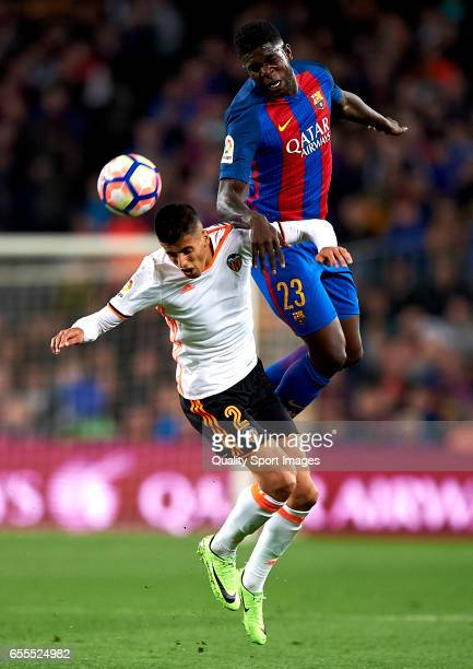 Samuel Umtiti of Barcelona competes for the ball with Joao Cancelo of Valencia during the La Liga match between FC Barcelona and Valencia CF at Camp...