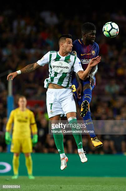 Samuel Umtiti of Barcelona competes for the ball with Sergio Leon of Betis during the La Liga match between Barcelona and Real Betis at Camp Nou on...