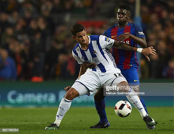 Samuel Umtiti of Barcelona competes for the ball with Willian Jose of Real Sociedad during the Copa del Rey quarterfinal second leg match between FC...