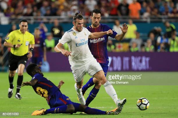 Samuel Umtiti of Barcelona defends against Gareth Bale of Real Madrid in the first half during their International Champions Cup 2017 match at Hard...