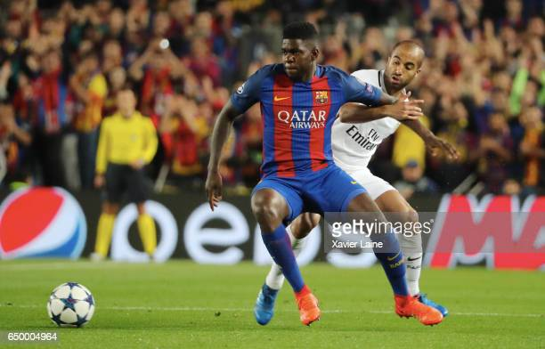 Samuel Umtiti of Barcelona FC in action with Lucas Moura of Paris SaintGermain during the UEFA Champions League Round of 16 second leg match between...
