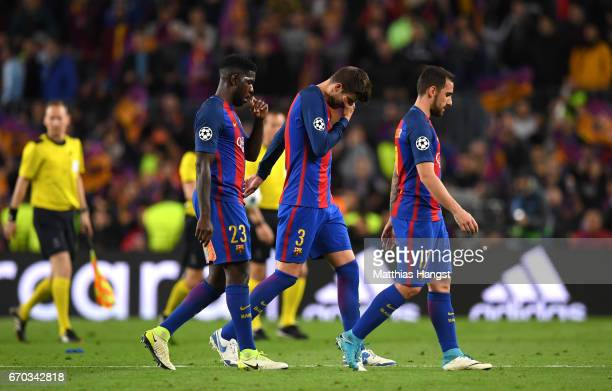 Samuel Umtiti of Barcelona Gerard Pique of Barcelona and Paco Alcacer of Barcelona look dejeced after the UEFA Champions League Quarter Final second...